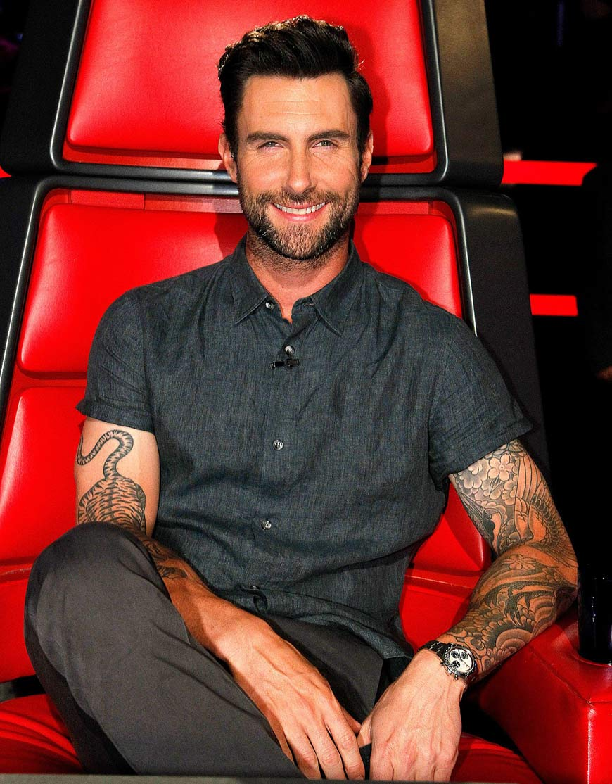Adam Levine sitting on Red Chair wirh Vintage Rolex Watch on His Wrist